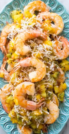 Sautéed shrimp topped with a mango pineapple kiwi salsa and toasted ...