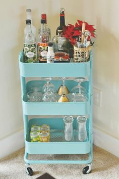 the ubiquitous IKEA RÅSKOG used as a bar cart.  Would be awesome to store in pantry and pull out when you have guests over for a couple drinks..