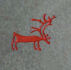 A copy of a rock carving of a reindeer from the Alta area of North Norway. The carvings were made from 6000-2500 years ago.: Historic Arctic Prints, art and artifacts: Arctic & Antarctic photographs, pictures & images from Bryan & Cherry Alexander Photography.