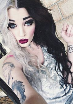 Black & white hair...interesting. it reminds me of Melanie Martinez from the voice
