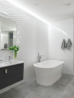 The textured tile wall! Wow. Alexander Nevsky St Apartment by Alexandra Fedorova