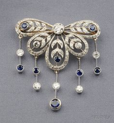 Edwardian Diamond and Sapphire Brooch, J.E. Caldwell & Co., bezel and bead-set with full-cut diamonds, diamond and sapphire melee fringe bezel-set on knife edge bars, approx. total diamond wt. 1.50 cts., platinum-topped gold mount, signed JEC & Co., F3931.
