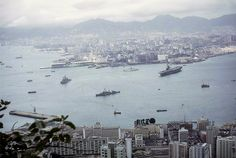 1966 Admiralty view from peak.  I wonder which aircraft carrier that is in the harbor? I think this is the early 70s because of all the warships and the way Ocean Terminal looks