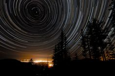 Star Trails Over Oregon   As the Earth spins on its axis, the sky seems to rotate around us. This motion, called diurnal motion, produces the beautiful concentric trails traced by stars during time exposures. Partial-circle star trails are pictured above over Grants Pass, Oregon, USA. Near the middle of the circles is the North Celestial Pole (NCP), easily identified as the point in the sky at the center of all the star trail arcs. The star Polaris, commonly known as the North Star.