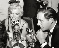 Marilyn with actor Sid Caesar in an interview with NBC at the Rose Tattoo premiere, 1955.