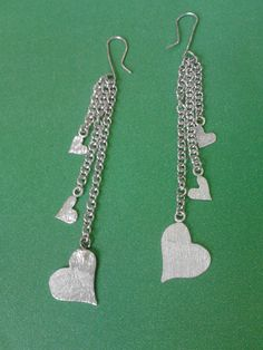 aretes de corazón hechos en plata por mi mismo :D
