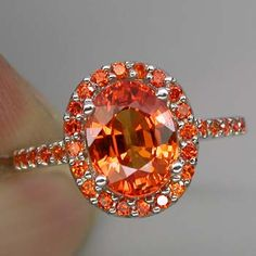 That is really pretty!   A fantastic bold orange Padparadscha Sapphire's in sterling silver.... (I love these bright orange sapphires...)