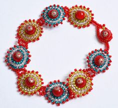 Mandala Bracelet  •  Free tutorial with pictures on how to do circular brick stitch around a a bead.  #Seed #Bead #Tutorials