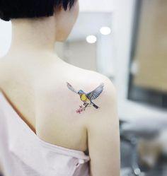 Back shoulder bird tattoo by Banul