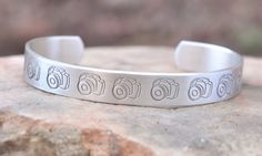 Photography bracelet - hand stamped bracelet cuff with cameras. $16.00, via Etsy.