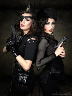Models: Jenna Moreci (left) Lisa Ryland (right)  Makeup & Hair: Lexy Lally  Jacket & vest by: http://www.skullncrossbows.com/  Hat, belt and eyepatch by: http://www.tanjaschroeder.dk/ (TS Rubber Bags)  Weapons: Steven Rojo  Photography/Wardrobe Styling: Silke Gabrielle — with Tanja Schrøder, Jenna Moreci, Topher Adam, Lexy Lally and Lisa Ryland.