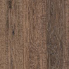 Mohawk Havermill Smoky Oak will swirl you into it's depths and hold you there. Deep graining adds contrast & character for a floor you will love for decades to come. American made, you know your family is safe with the high manufacturing standards. Smoky Oak has striking graining to give it the look and feel of real oak flooring, but with the durability of laminate! Product Features: 12mm AC4 durability rating Beveled Edge ArmorMax Finish to protect your floors Limited Li...