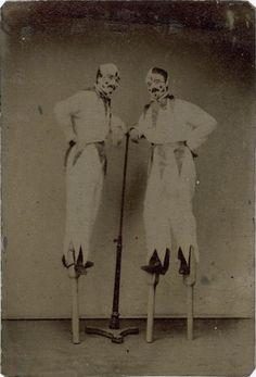 ca. 1875, [portrait of two clowns on stilts]