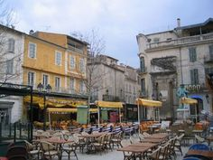 Arles, France - I love that you can see the old Roman facade that they built around for the hotel across the street from the cafe....
