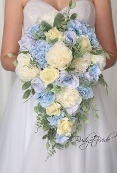 This is a stunning bouquet made with ivory roses, ivory peonies and baby blue accents with tons of greenery all made with fake flowers! Hydrangea Bridal Bouquet, Cascading Wedding Bouquets, Cascade Bouquet, Blue Wedding Flowers, Blue Bouquet, Bride Bouquets, Bridal Flowers, Bouquet Flowers, Fake Flowers