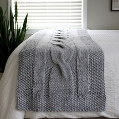 River of Dreams is a chunky, modern bed runner which features a giant cable and seed stitch border. This accent blanket adds a layer of coziness to your bed! The bold cable design adds texture and interest to any decor style.