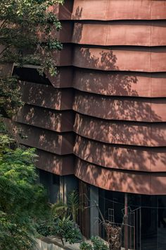 "Created in response to the ""hostile"" local environment, the three-storey building was wrapped in a banded Corten-steel shell to protect it. Corten Steel, Shells, Rugs, Reclaimed Windows, Indian Architecture, Dezeen, Windows And Doors, Facade, Architecture"