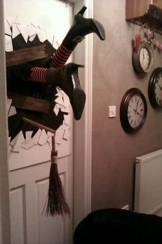 I think I could make this with a pair of mannequin legs and thrift shop boots, and holiday stockings or socks. A witch crashing through a door. DIY Halloween Door Decor