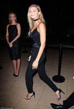 Gigi Hadid Style - She looked lovely in a black jumpsuit with spaghetti straps and satin panelling #womenswear #celebrity #style #summer #black