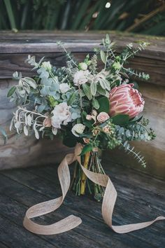 beautiful protea wedding bouquet you worth to copy right now Protea Bouquet, Protea Wedding, Floral Wedding, Bride Bouquets, Bridesmaid Bouquet, Flower Decorations, Wedding Decorations, Campground Wedding, Wedding Bouquets