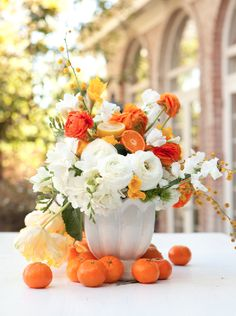 Use citrus in floral design...fresh, fun, fragrant... I may have to experiment. Would pomegranetes (sp?) be amazing?!