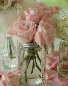 Roses, hydrangeas, peonies, and garden roses in mason jars with pearls and lace