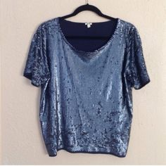 """J.Crew Blue Sequin Shortsleeve Boxy Top Great condition! Perfect for a holiday event! Sequins are folded up in certain areas making it appear that some are missing. However only noticed one small spot missing sequins at the back of one sleeve (about 4). Shortsleeves, boxy-loose fit, length is approx 21"""" and width across chest under armpits is approx 21"""". ❌NO TRADES OR PAYPAL❌ J. Crew Tops"""