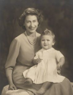 Princess Elizabeth (future Elizabeth II) with son Prince Charles, 1949. Prince Charles is aged about 11 months. Photo taken on 26 October 1949 by Marcus Adams.