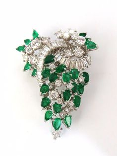 Original Cocktail Love Classic Emerald diamonds dangling Pendant Brooch 5.00ct. natural emeralds Pear shapes. Clean Clarity, Transparent & Vivid Greens. 6.00ct natural diamonds. Baguette, Round, & 1 M