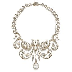 Diamond necklace, circa 1900 Of scroll and foliate motifs, set with cushion-shaped, circular-, single-cut and rose diamonds, length approximately 400mm, five central motifs detachable, additional fittings deficient.