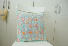 """Cushion Cover Cathedral Window Grey Aqua and Orange 18""""X18"""". Pillow cover."""