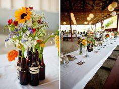 Floral arrangement with beer bottles.