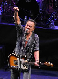 """Bruce Springsteen Singer/songwriter Bruce Springsteen performs during the 2012 Light of Day Concert Series """"New Jersey"""" at the Paramount Theatre on January 14, 2012 in Asbury Park, New Jersey."""