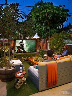 The garden living room is a sunny, green spot in the daytime. Subtle outdoor lighting sets the whole garden aglow in the evenings. On movie nights, a screen pulls down from a custom-made trellis. Keeping the space tidy is easy: It takes about 10 minutes with a leaf blower on the low setting./
