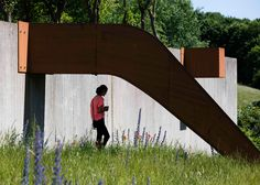 This ribbon of weathering steel meanders through a Copenhagen housing estate, creating a path, slide and aerial walkway