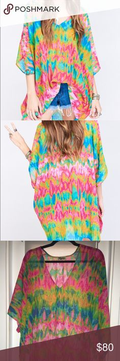 Show Me Your Mumu Heat Wave Peta Tunic Fun, flowy, super flattering tunic! The colors are vibrant and beautiful. Excellent condition barely worn Show Me Your MuMu Tops Tunics