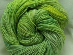 Handdyed Sparkle Sock Yarn in Sprout by dragonflydyeworks on Etsy.