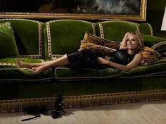 Green velvet sofa with trim