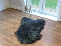 Stunning Natural Black Icelandic Sheepskin Rug. Superior Soft, Supple Hide & Gorgeous Long Fleece make them the perfect Statement Piece for your Home.