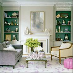 I love everything about this room...  lavender...table...mirror...teal back on bookcases...