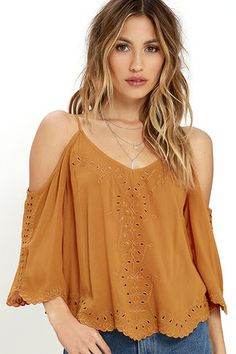 We're suckers for a modern romance, and the Contemporary Fairytale Burnt Orange Embroidered Top is here to make heart-eyes happen! Pierced embroidery dances across a loose, woven silhouette with cold shoulder cutouts, fluttering sleeves, and a scalloped hem.