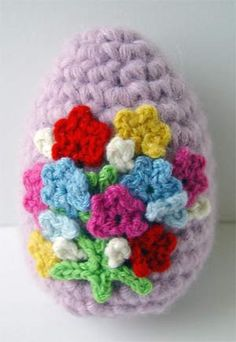 crochet flowers egg    Crocheted from cashmere yarn, stands about 4 inches tall.