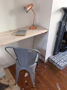 You could slot a nice timber desk in the alcove with a lamp and nice chair, or pop a telly on for chilling back