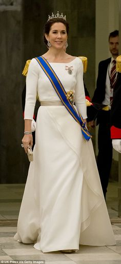 Fit for a princess: She wore this off-white, three-quarter-sleeve gown that cinched at the waist to attend a State Banquet at Christiansborg Palace during the state visit of the King and Queen of the Netherlands in March