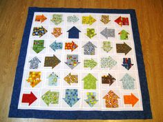so cute. baby boy's quilt. On the Go from Moda. complete instructions. free. uses charm squares.