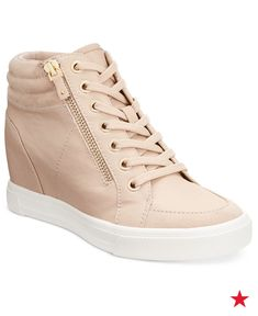 Looking for the perfect street-chic shoe? Aldo's Ottani sneakers are the perfect day-to-play style with its gold-tone zipper details and hidden wedge heel. Pair them with ripped black skinny jeans or even a dress to create a cool, chic vibe. Score them in nude, black or white at macys.com now.
