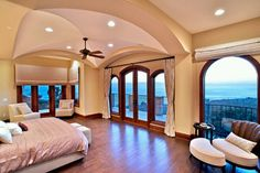 Love the big windows with the high ceiling. It opens up the room and makes it feel more spacious.