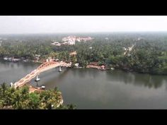 "A view of Kerala from AMMA ashram in ""Amritapuri"".  http://www.amritapuri.org/ashram/  What this video does not portray is the exquisite chants blaring from the ""temples"" along the river at sunrise, (a good thing).  Amma's ashram is not what it used to be; no more Devi Bhava's on Sundays - those were like Heaven on Earth, and much less accomodation than before, the girl students using at least two of the apartment blocks.  Don't expect there to be a lot of spiritual disciplines happing."
