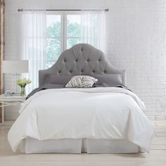 Made of a wood frame with cushiony fill, this Skyline Furniture Arch Tufted Headboard gives your bed frame a complete look. Upholstered in linen, this grey headboard features tufted detailing and an arch construction.