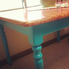 Completed Kitchen Table - had white legs and a blonde table top - now has teal legs and a red mahogany streaked top
